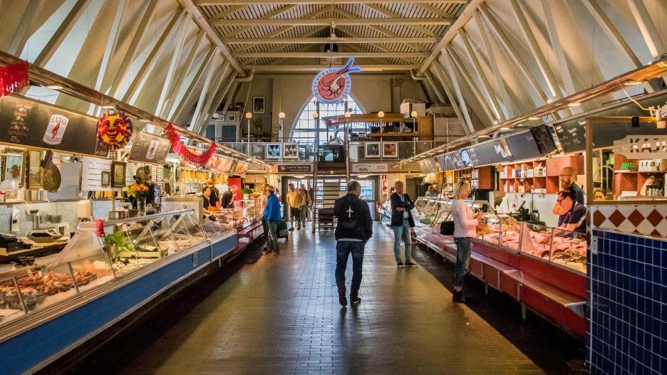 Man walking through a fish market
